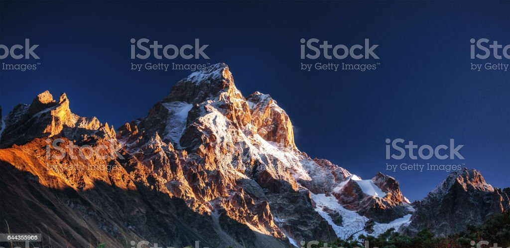Fantastic scenery and snowy peaks in the first morning sunlight. stock photo