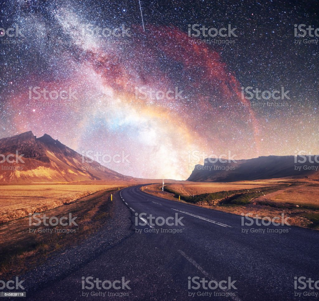 Fantastic starry sky and majestic mountains in the mist. Dramatic  beautiful morning. Autumn landscape. Courtesy of NASA stock photo
