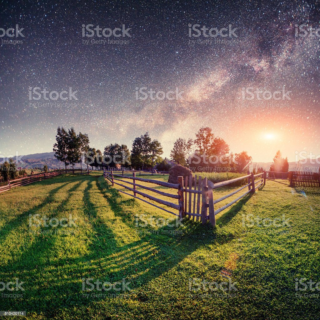 Fantastic starry sky stacks and traditional mountain villages. stock photo
