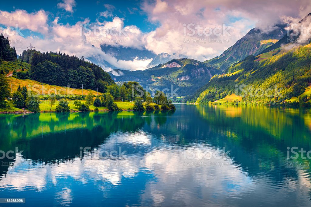 Fantastic summer morning on Lungerersee lake. stock photo