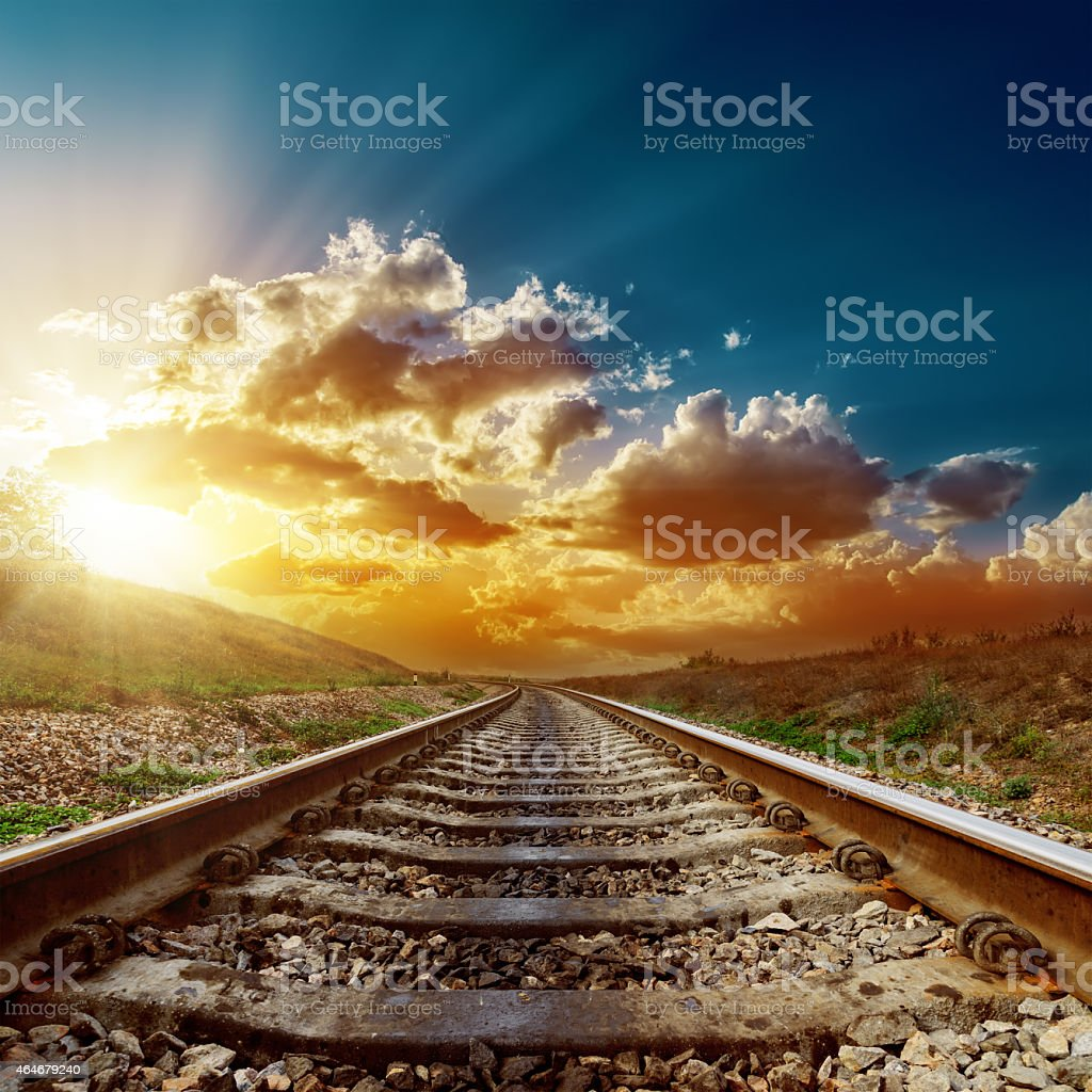 fantastic sunset over railroad to horizon stock photo
