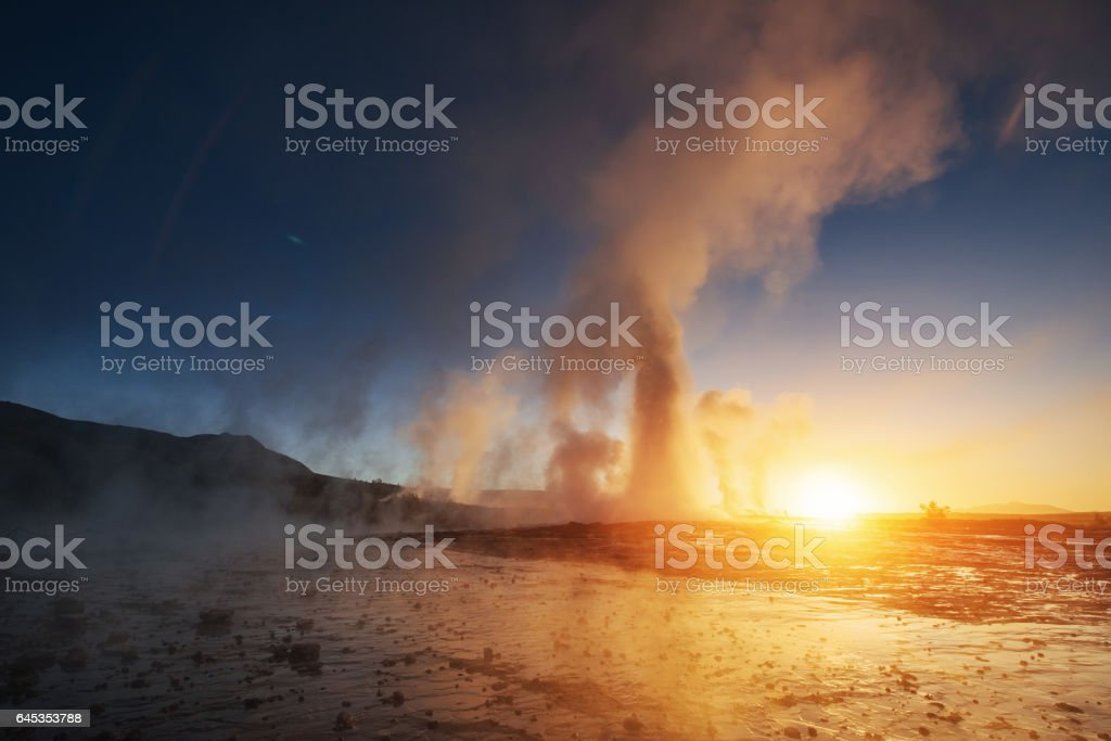 Fantastic sunset Strokkur geyser eruption in Iceland stock photo