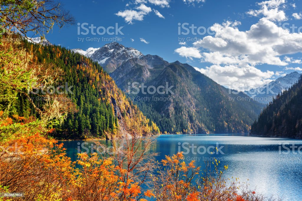 Fantastic view of the Long Lake among mountains and fall woods stock photo