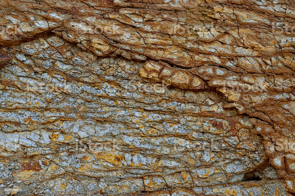 Fantastically coloured rock with cracks weathering. stock photo