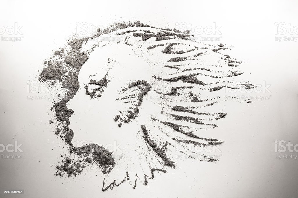 Fantasy girl head drawing in dust, ash, sand, dirt stock photo
