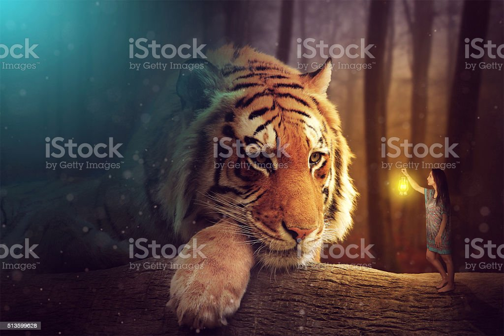 Fantasy world - a woman and a giant tiger stock photo
