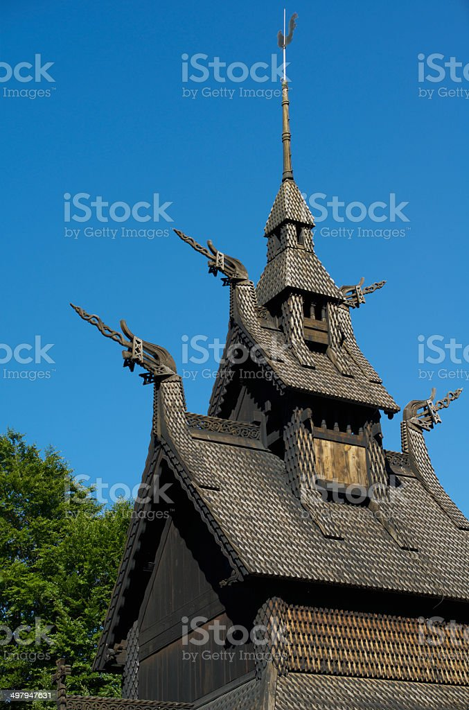 Fantoft Stave Church, green foliage and clear blue sky royalty-free stock photo