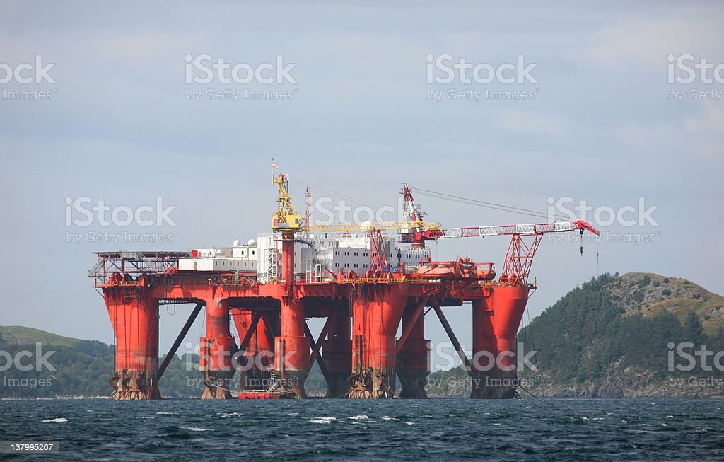 A far away picture of a oil platform royalty-free stock photo