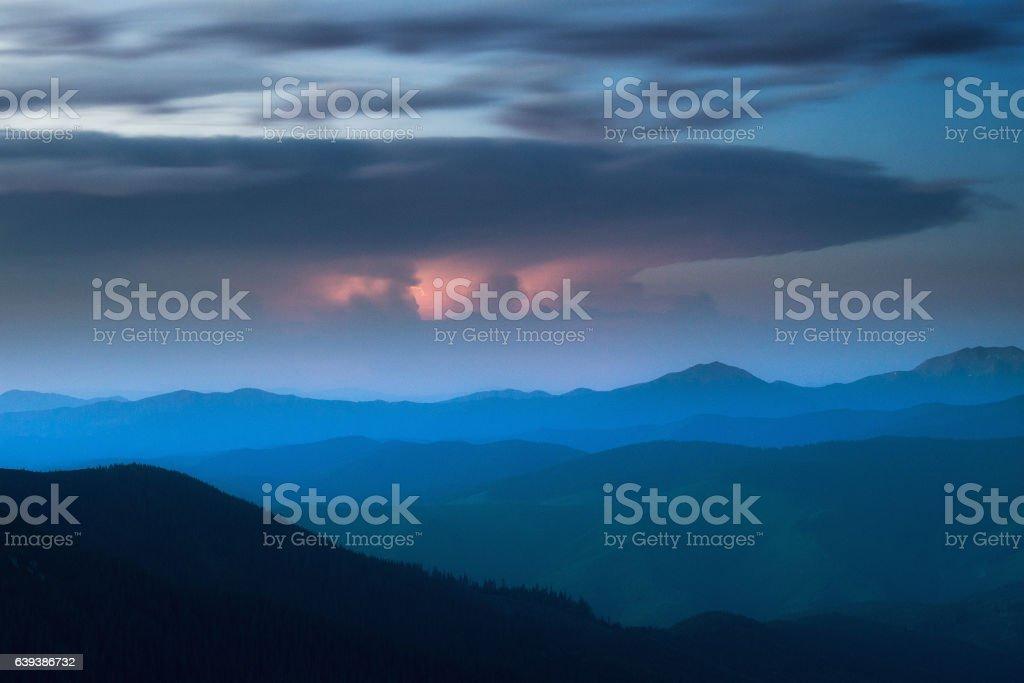 far beyond mountains storm stock photo