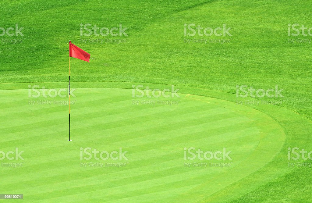 Far Shot of a Red Flag on a Golf Green stock photo