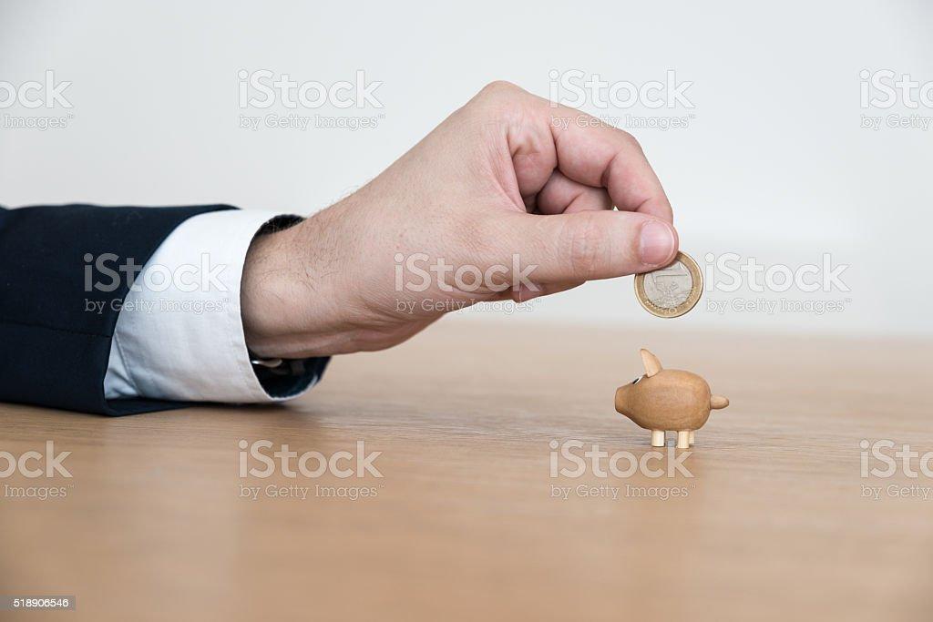 Far too little piggy feed Euro stock photo