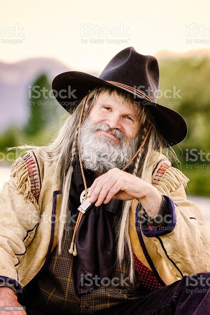 Far west mountain man portrait with harmonica royalty-free stock photo