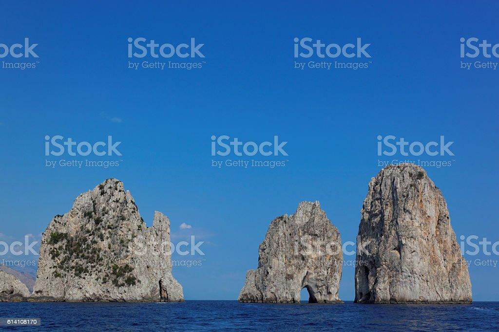 Faraglioni rocks at Capri island, Mediterranean Sea, Italy stock photo