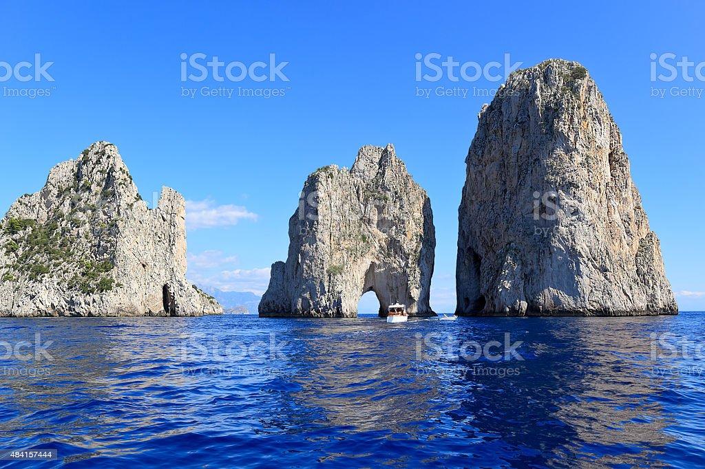 Faraglioni - three famous rocks, Capri island (Italy) stock photo