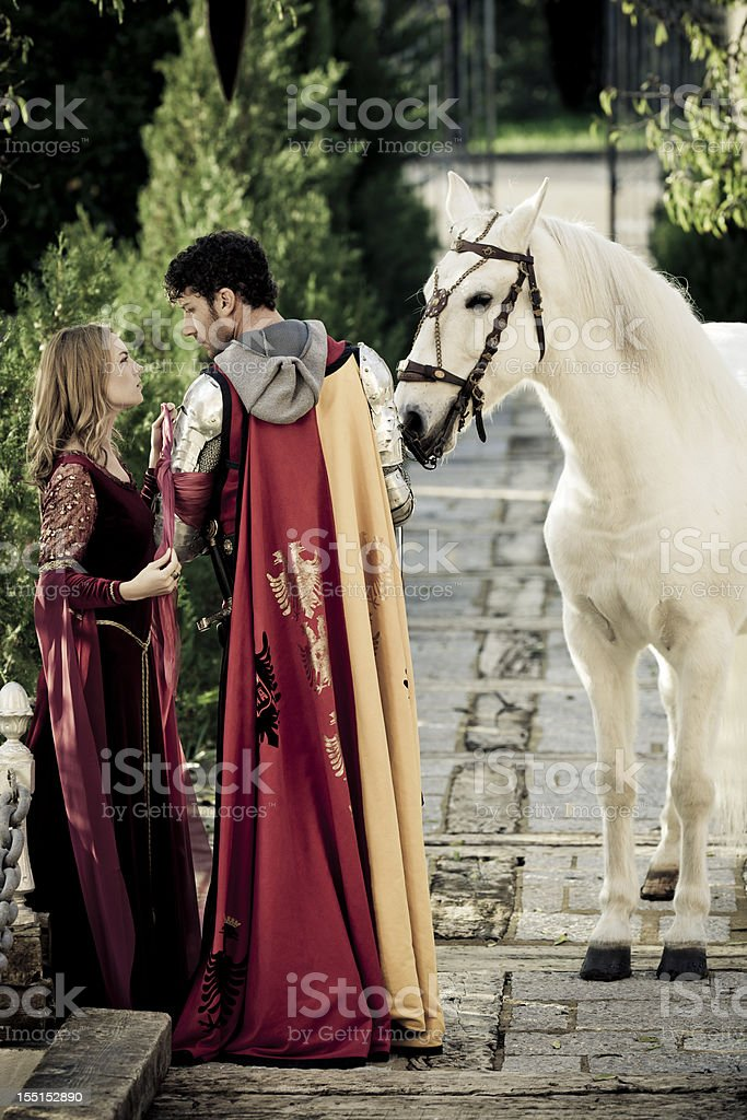 farewell between medieval knight and lady stock photo