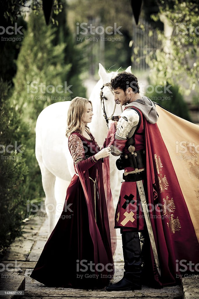 farewell between medieval knight and princess stock photo