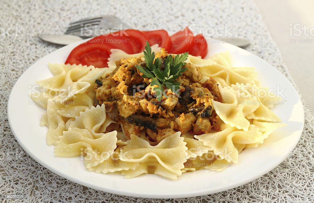 Farfalle with chicken fillet and mushrooms stew royalty-free stock photo