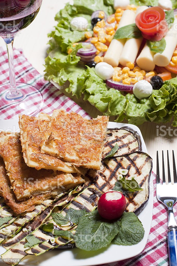 Farinata sliced with grilled vegetables royalty-free stock photo