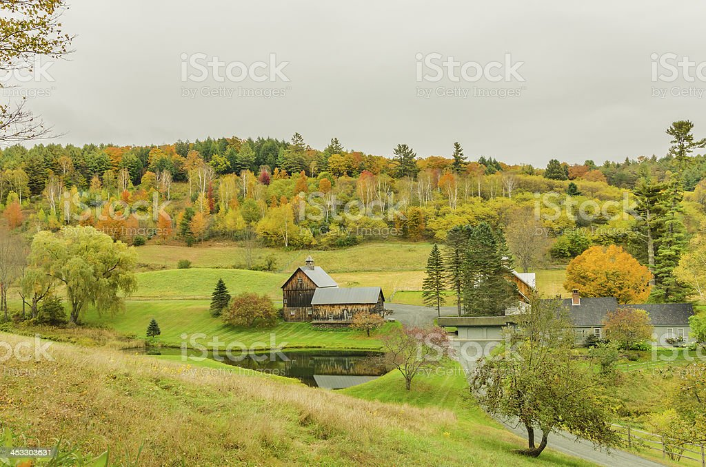 Farm and Cloudy Sky in Autumn stock photo