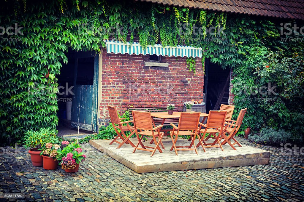 Farm backyard with  table and chairs stock photo