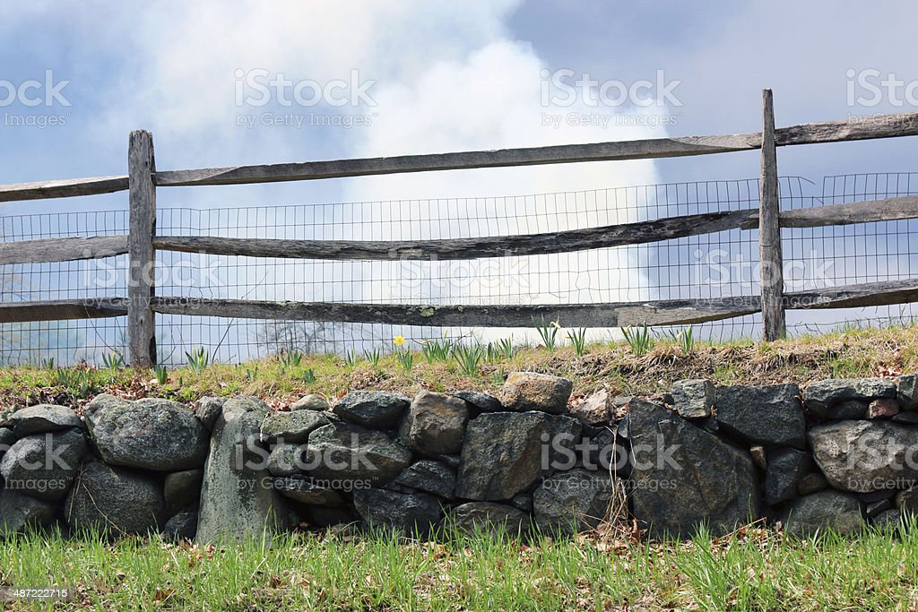 farm fence with looming sky stock photo