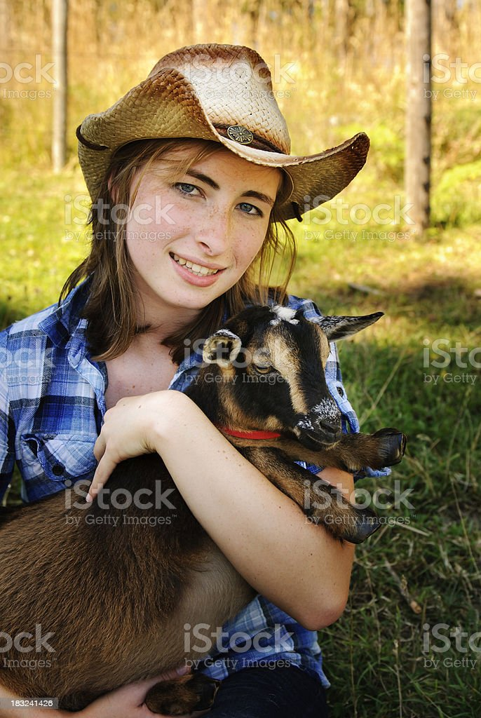 Farm Girl and Goat royalty-free stock photo