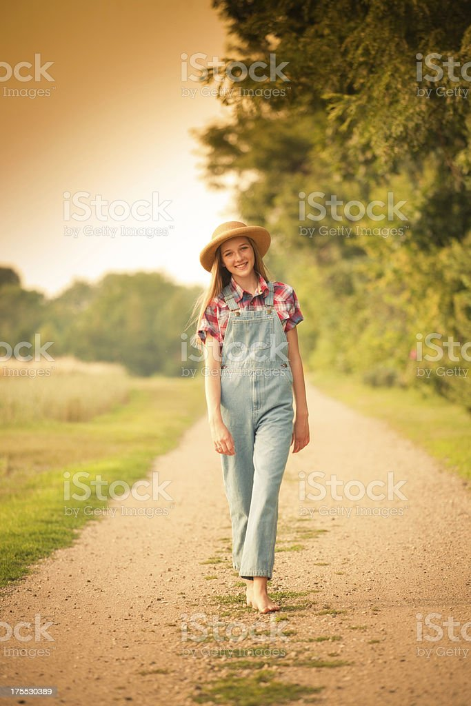 Farm Girl Walking in Country Road by Field Vt royalty-free stock photo