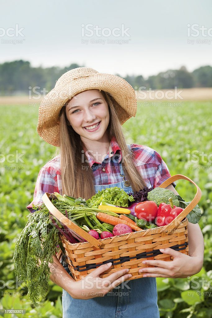 Farm Girl with Basket of Freshly Harvested Produce Vegetables Vt royalty-free stock photo