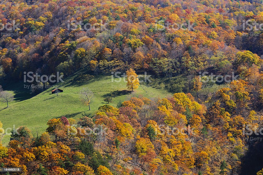 Farm house surrounded by colorful Autumn forest stock photo