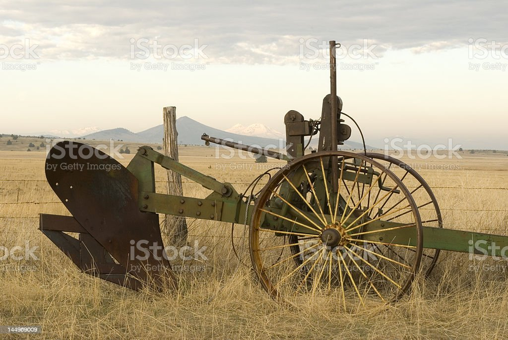 Farm Implement and Mountains royalty-free stock photo