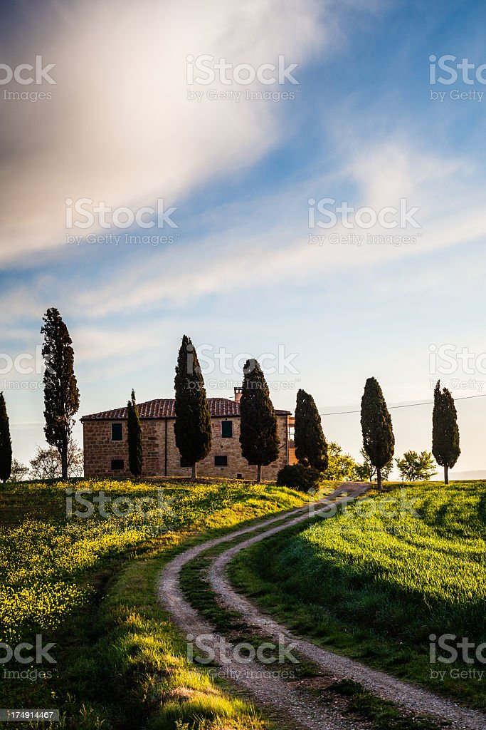 Farm in Tuscan hills royalty-free stock photo