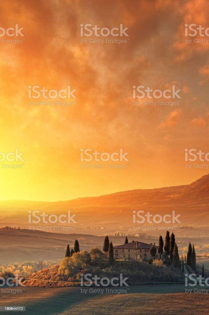 Farm in Tuscany at sunrise. stock photo