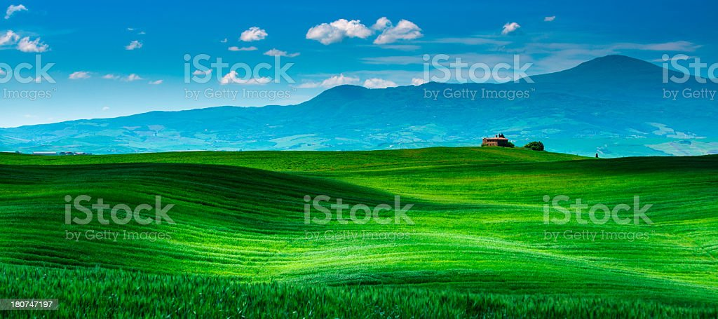 Farm in Tuscany with rolling hills royalty-free stock photo