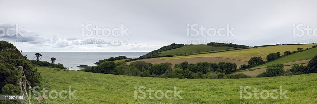 Farm land, seascape and lighthouse. royalty-free stock photo