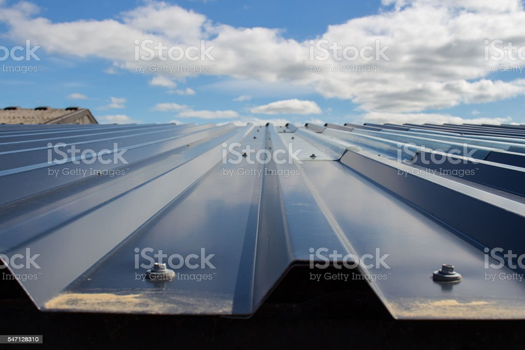 Farm roof and sky stock photo