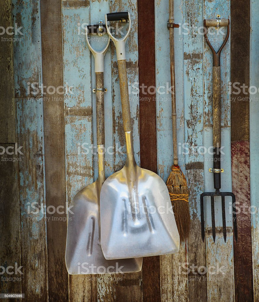 farm tool pitchfork and two shovels stock photo