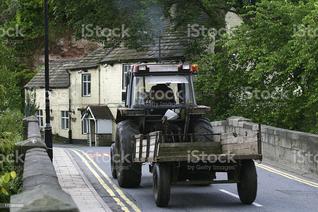farm tractor in English village royalty-free stock photo