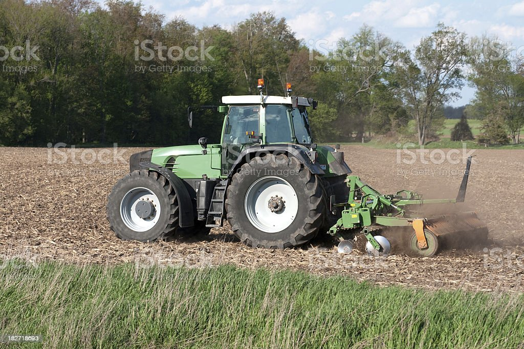 Farm Tractor in Spring stock photo