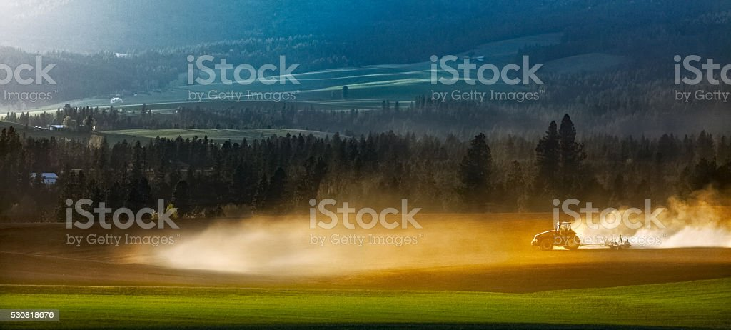 Farm Tractor Plowing Field stock photo