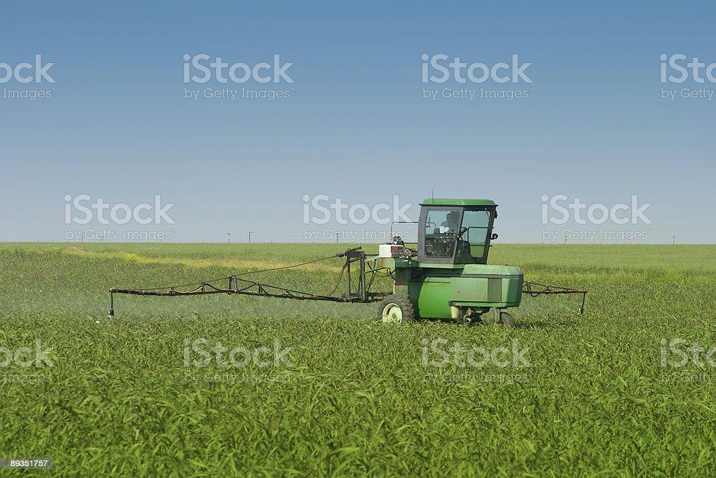 Farm Tractor Sprayer In Field royalty-free stock photo