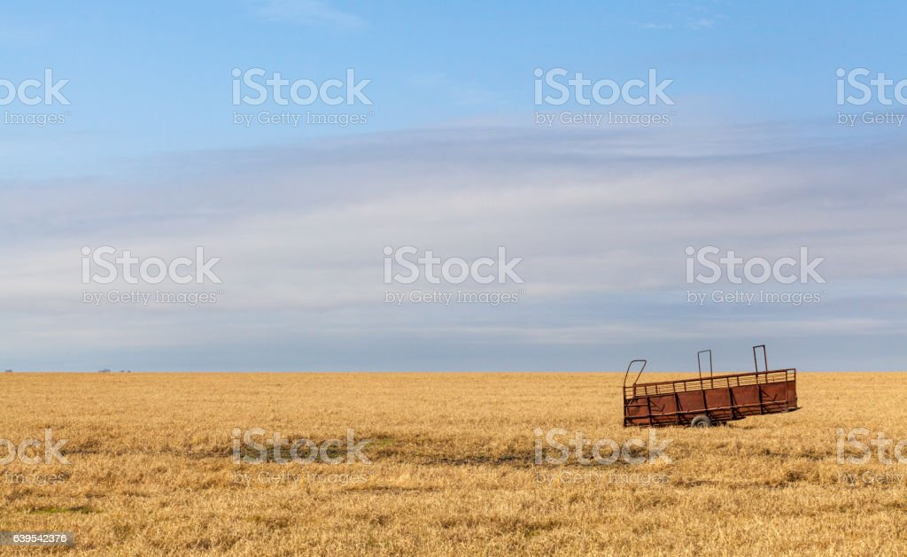 Farm trailer in the Middle of Field stock photo