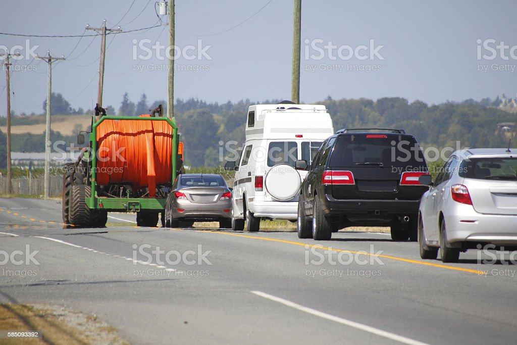 Farm Vehicle Slowing Traffic stock photo