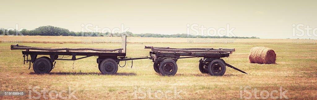 Farm wagon in the field. stock photo
