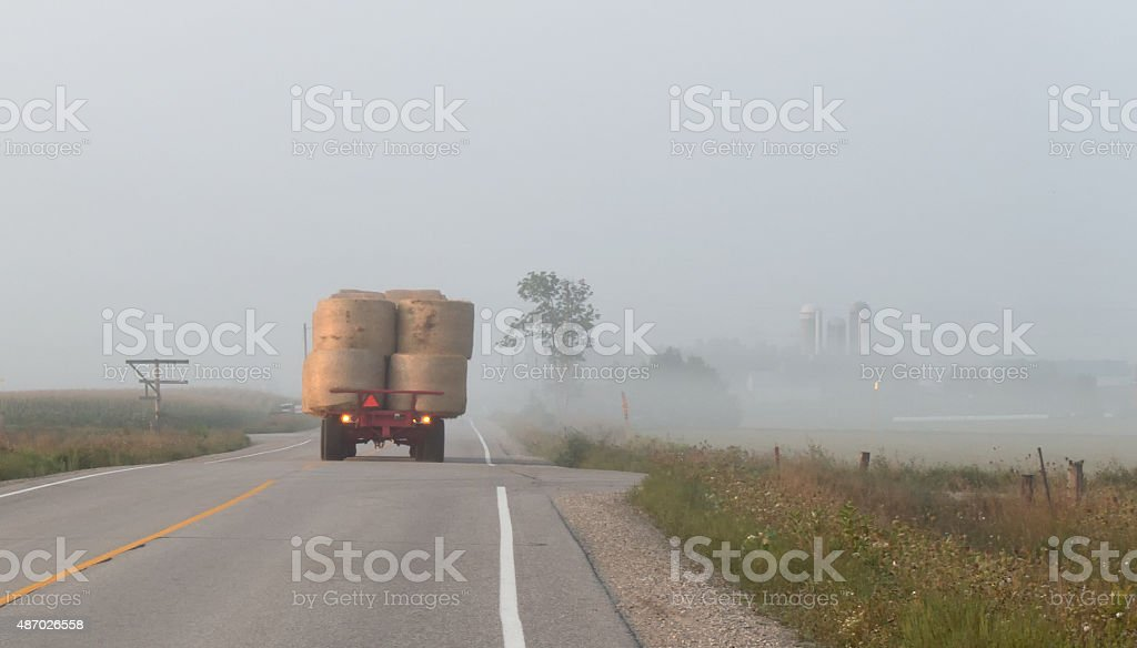 Farm Wagon on Country Road stock photo