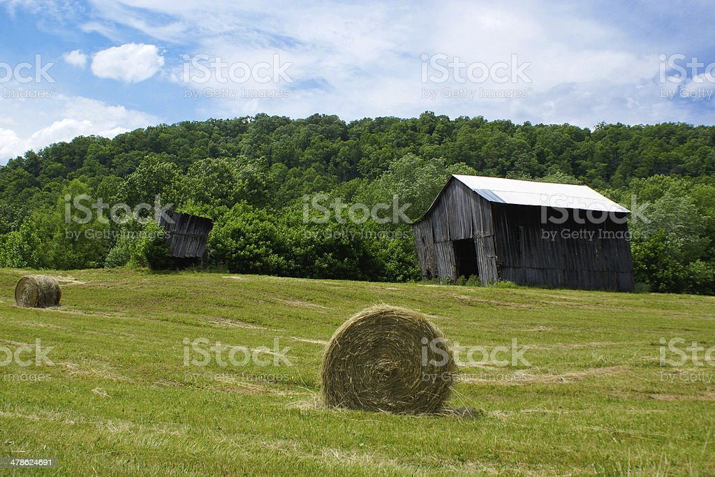 Farm with Barn and Hay Bail stock photo