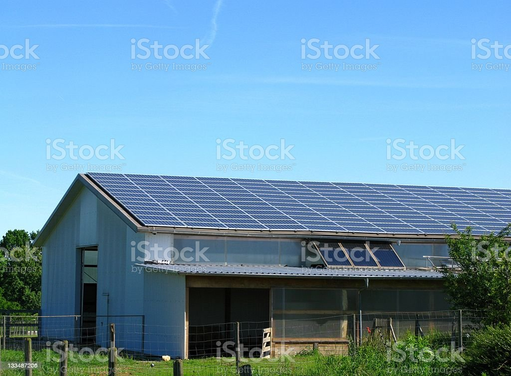 Farm with solar panels on roof royalty-free stock photo