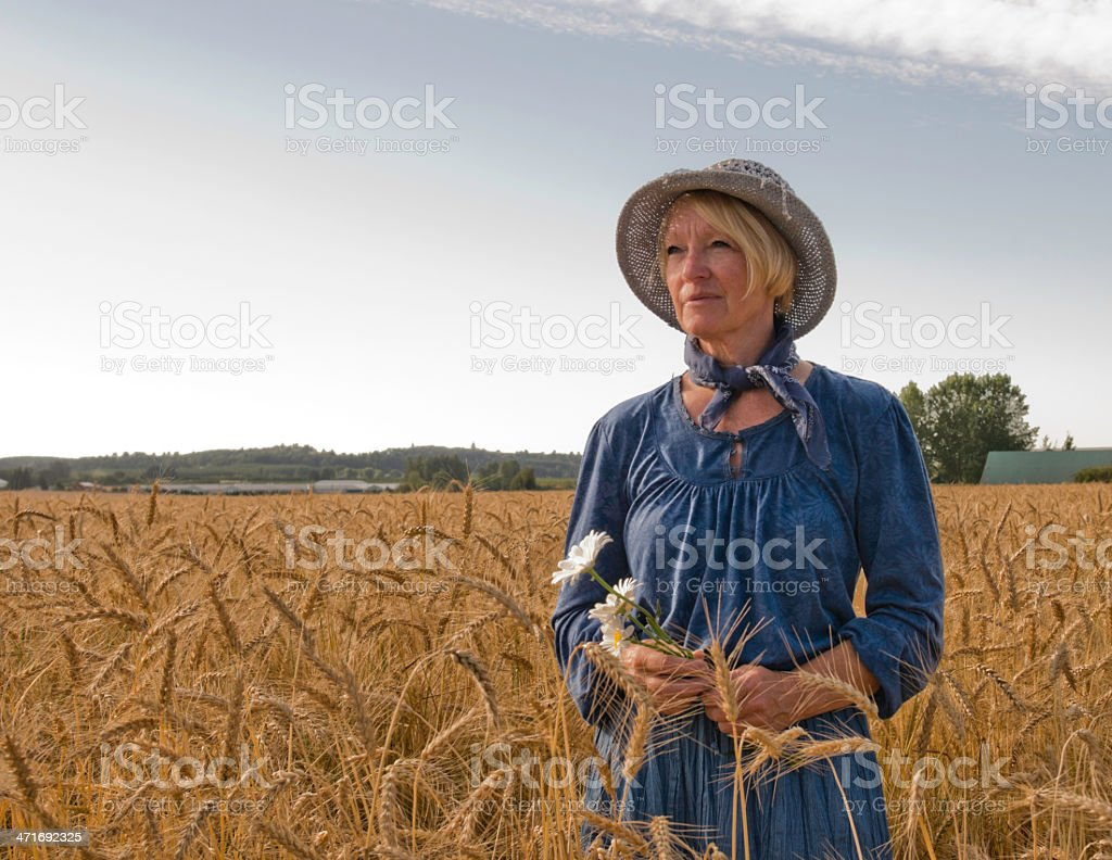 Farm Woman standing in a grain field royalty-free stock photo