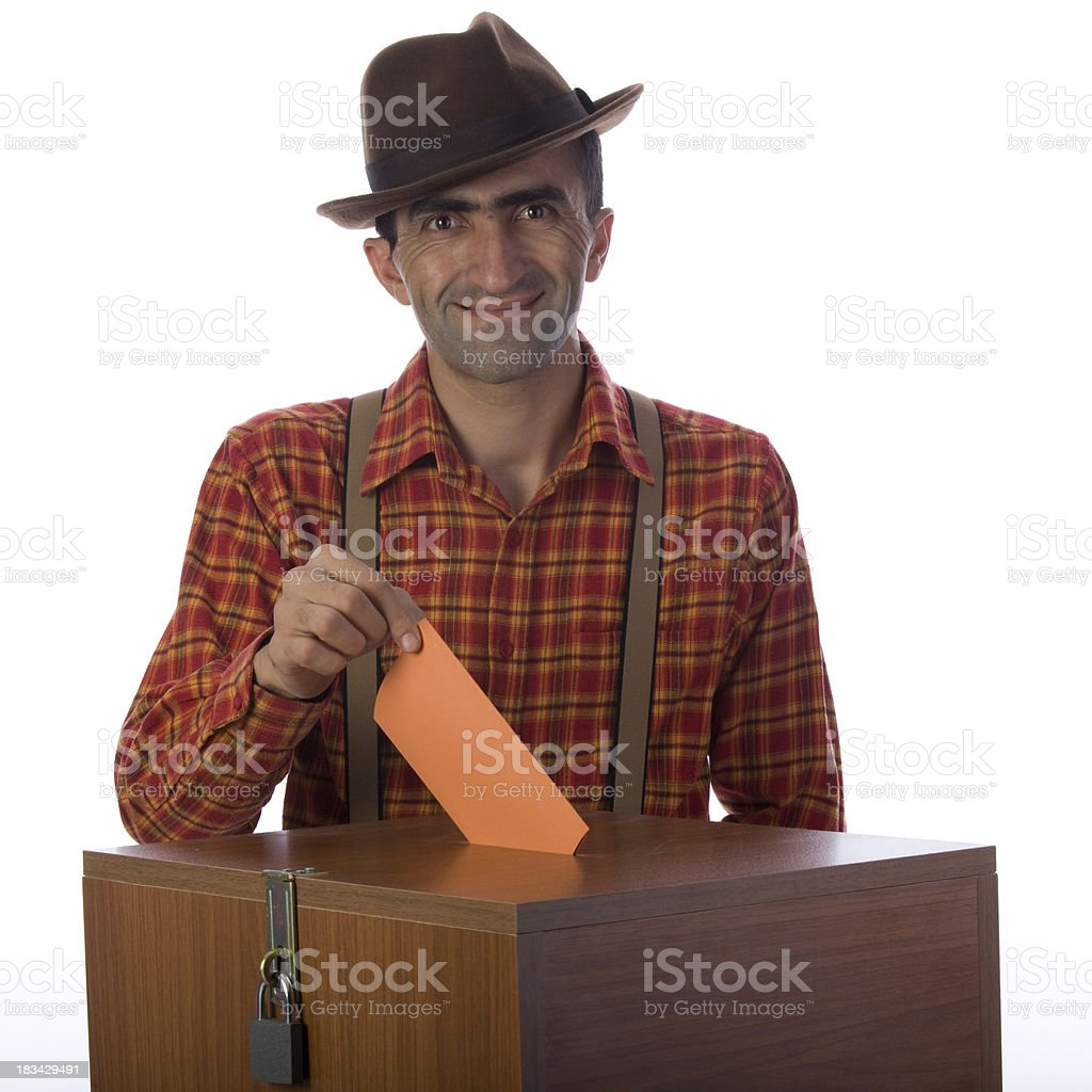 Farm worker voting on ballot box for political power royalty-free stock photo