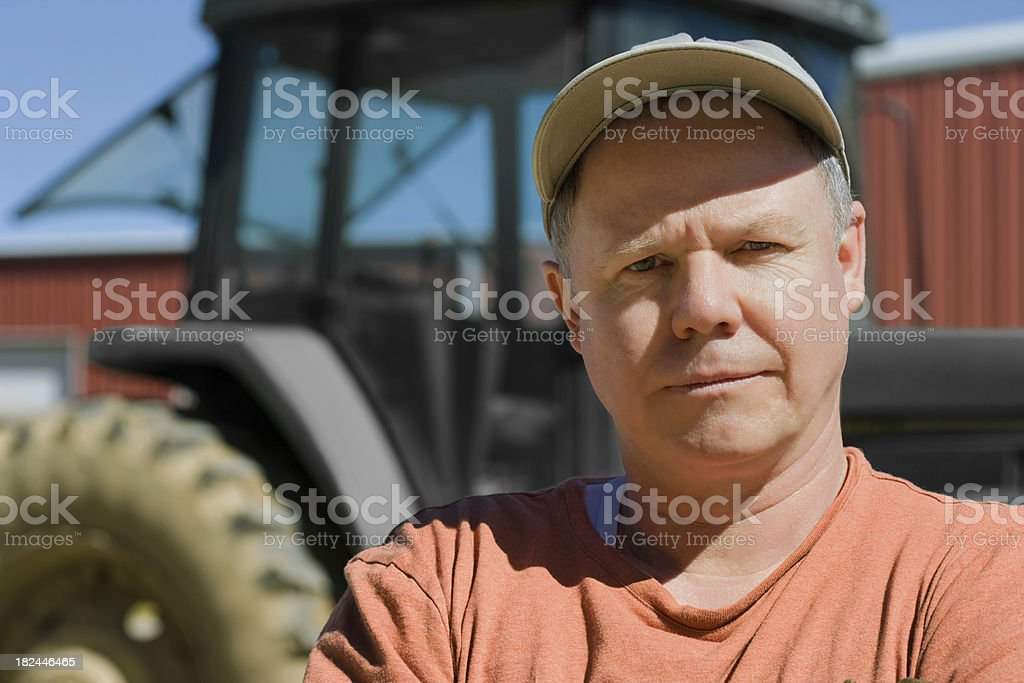 farm worker with tractor royalty-free stock photo