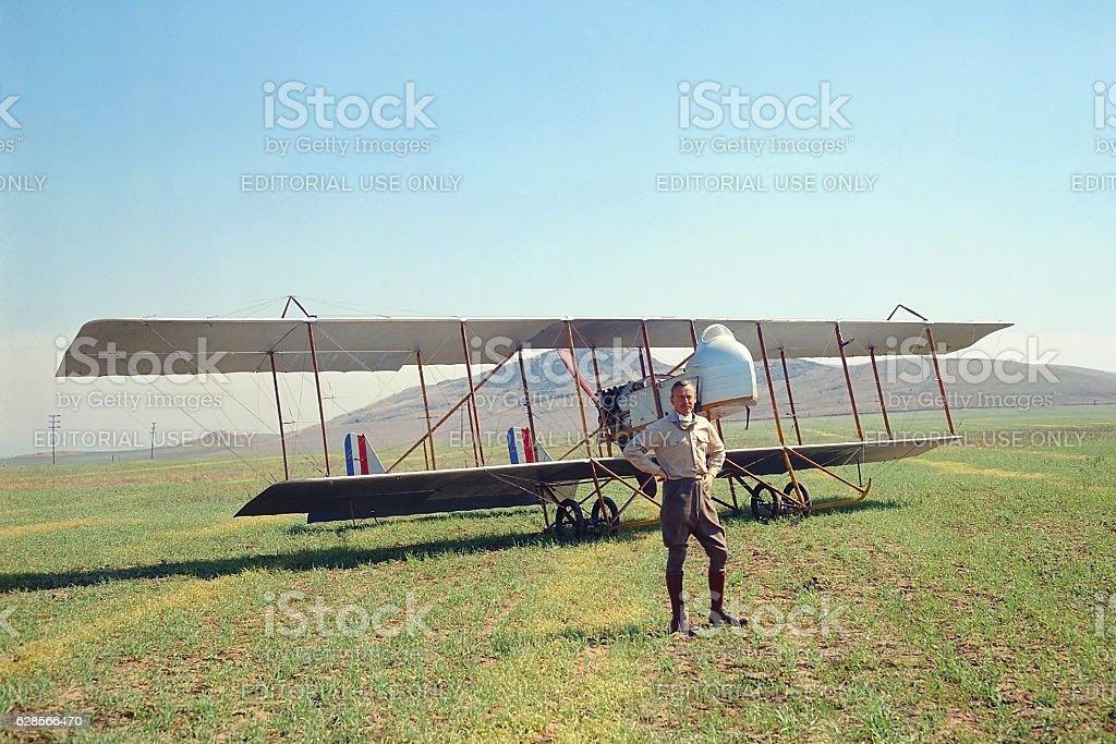 Farman MF.11 1914 biplane in field with Frank Tallman stock photo